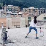 Two Women Playing Rooftop Tennis in Seguria, Italy