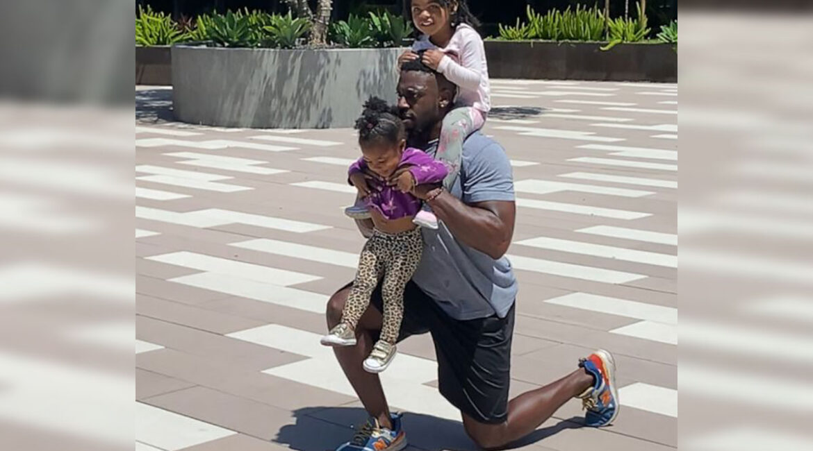 Ose Akhile working out with his kids